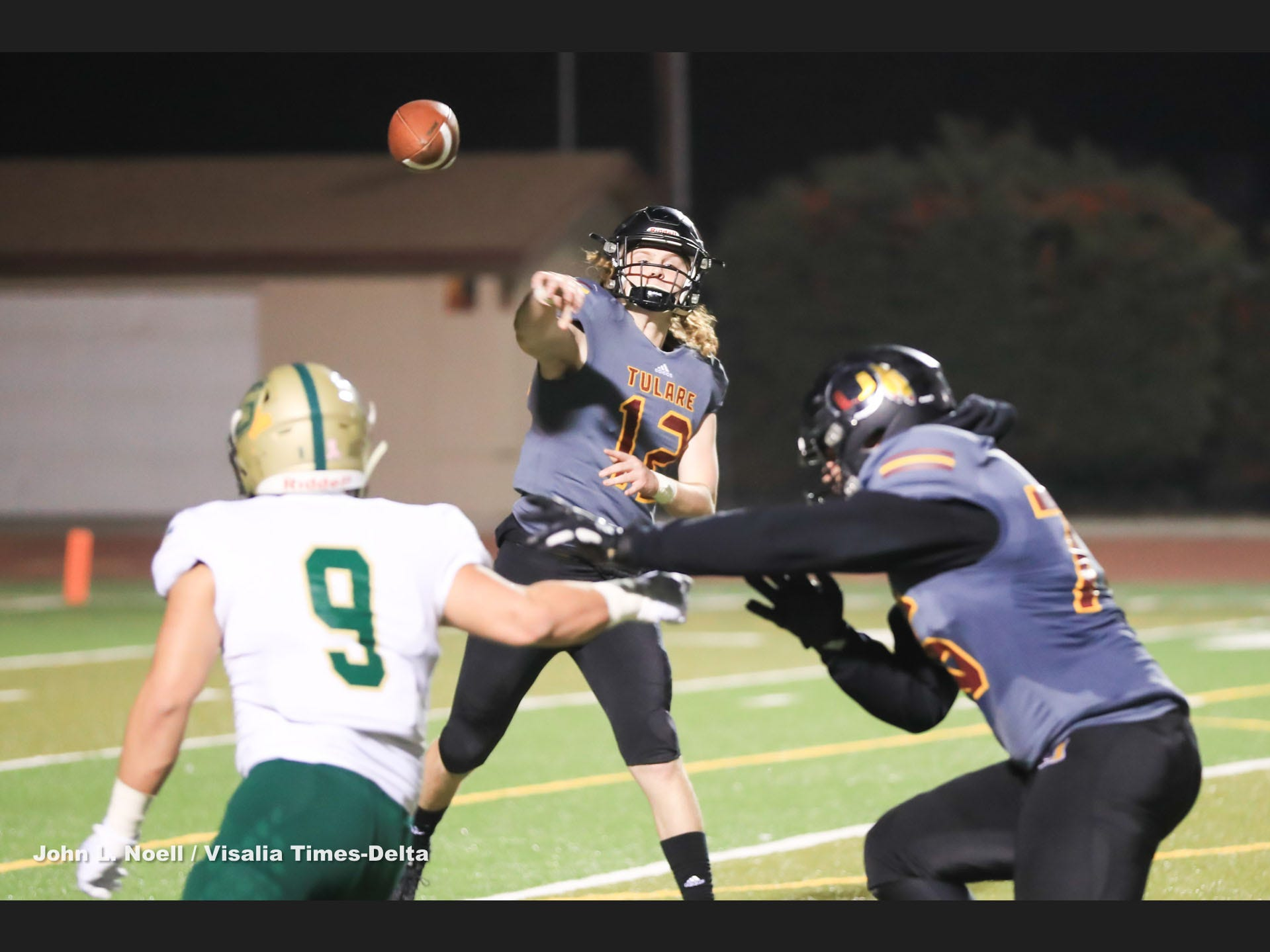 Tulare Union's Nathan Lamb (12) passes against against Garces Memorial in a Central Section Division II quarterfinal high school football game at Bob Mathias Stadium on Nov 9th, 2018.