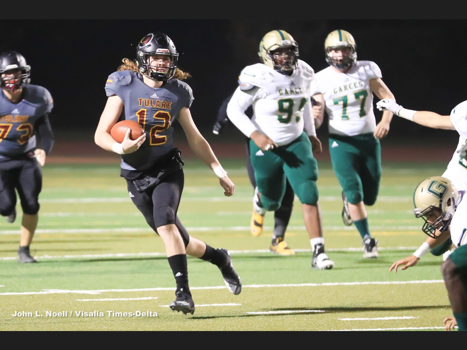 Tulare Union's Nathan Lamb (12) rushes in open field against Garces Memorial in a Central Section Division II quarterfinal high school football game at Bob Mathias Stadium on Nov 9th, 2018.
