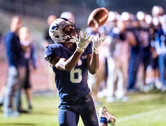 Central Valley Christian's Brian Noel takes a pass to score against Washington Union in a Central Section Division IV quarterfinal high school playoff on Friday, November 9, 2018.