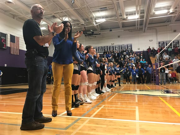 Ardsley volleyball head coach Dave Ponterio and his team applauds Owego Free Academy the Class B regional final at John Jay-Cross River. OFA swept Ardsley for the win. Nov. 10, 2018.