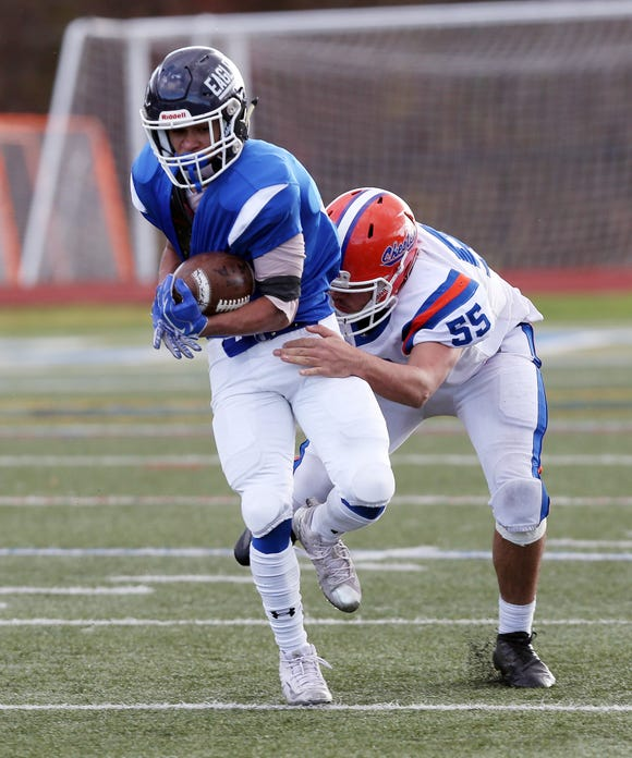 Dobbs Ferry's Emilio Nolasco (10) tries to break away from a Chester defender during the regional championship game at Mahopac High School Nov. 9, 2018. Dobbs Ferry won the game.