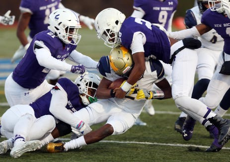 New Rochelle's defense stops Newburgh's Terry Anderson (2) during the Class AA regional championship game at Mahopac High School Nov. 9, 2018.