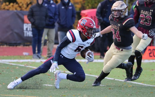 Stepinac's Shawn Harris Jr. gets past Iona Prep's Danny Riccio during their semifinal at Iona Prep Nov. 10, 2018. Stepinac won 37-26.