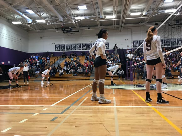 Ossining players prepare to return a serve from Pine Bush in the Class AA regional finals at John Jay-Cross River High School. Nov. 10, 2018.