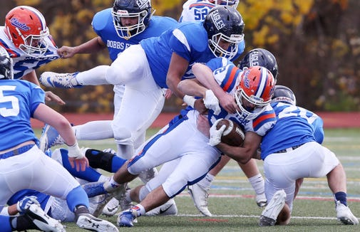 Dobbs Ferry defenders stop a Chester run during the regional championship game at Mahopac High School Nov. 9, 2018. Dobbs Ferry won the game.