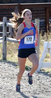 Katie Turk from Carmel runs the girls Class A race during the 2018 NYSPHSAA Cross Country Championships on Nov. 10.