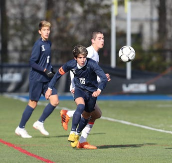 Briarcliff's Alex Cabeca (10) works the ball near midfield during their 1-0 win over East Aurora in the Class B Boys State Soccer Semifinal at Middletown High School in Middletown on Saturday, November 10, 2018.