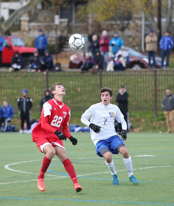 Somers' Ethan Cukaj (22) works a header during their 2-1 win over  Queensbury in the Class A Boys State Soccer Semifinal at Mount St. Mary College in Newburgh on Saturday, November 10, 2018.