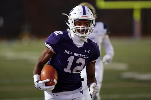 New Rochelle's Jessie Parsons (12) runs for a first half touchdown against Newburgh  during the Class AA regional championship game at Mahopac High School Nov. 9, 2018.