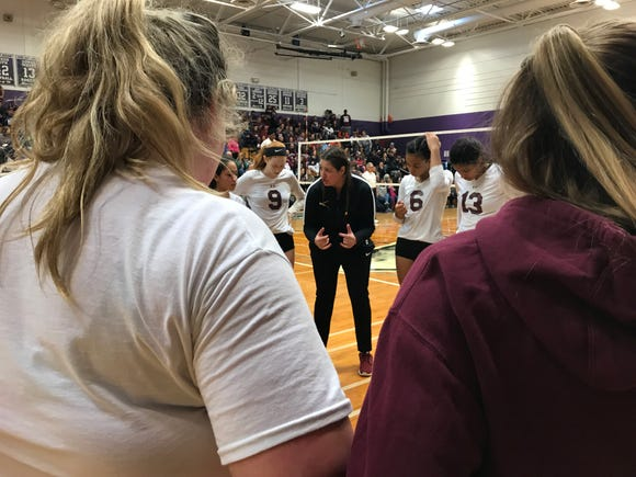 Ossining volleyball head coach Lauren Riccardi talks to her team during a timeout in the Class AA regional finals against Pine Bush at John Jay-Cross River High School. Nov. 10, 2018.