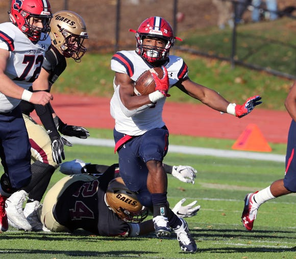 Stepinac's Malik Grant carries the ball during a semifinal at Iona Prep Nov. 10, 2018. Stepinac won 37-26.