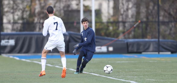 Briarcliff's James Varriano (3) centers a pass during their 1-0 win over East Aurora in the Class B Boys State Soccer Semifinal at Middletown High School in Middletown on Saturday, November 10, 2018.