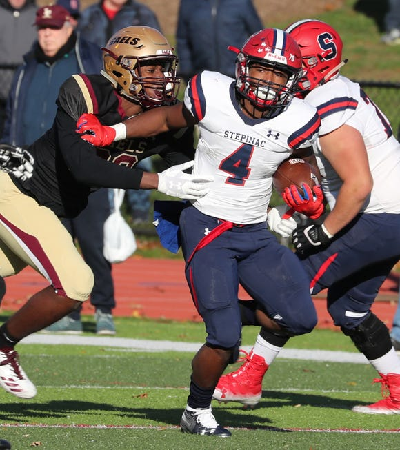 Stepinac's Malik Grant breaks away from Iona Prep's Nick Gadson during their semifinal at Iona Prep Nov. 10, 2018. Stepinac won 37-26.