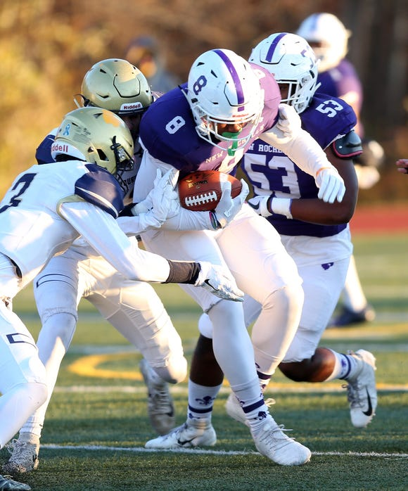 New Rochelle's Jordan Forrest (8) looks for some running room in the Newburgh defense during the Class AA regional championship game at Mahopac High School Nov. 9, 2018.