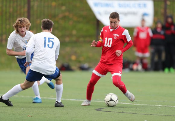 Somers' Lucas Fecci (11) cuts on Queensbury defender Alex Chirgwin (15)  during their 2-1 win over Queensbury in the Class A Boys State Soccer Semifinal at Mount St. Mary College in Newburgh on Saturday, November 10, 2018.
