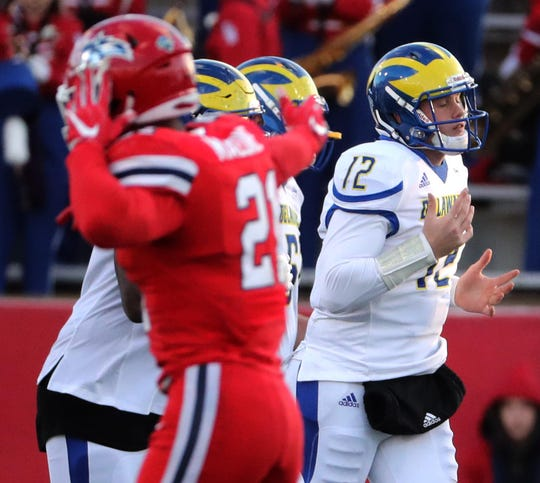 Delaware quarterback Pat Kehoe comes off the field after he was sacked on fourth down late in the fourth quarter of the Blue Hens' 17-3 loss at Stony Brook Saturday.