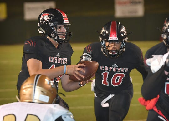 Wichita Falls High running back Isaiah Cherry (10) takes the handoff from Anthony Vargas in the the first quarter of the Coyotes' game against Rider.