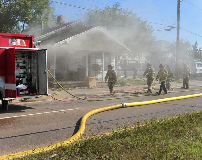 Wichita Falls firefighters work to contain a structure fire at a duplex located in the 1600 block of Broad Street Friday morning.