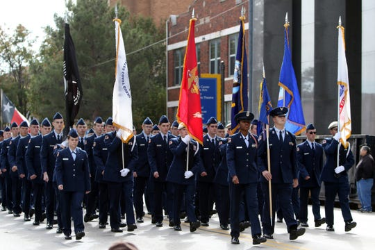 The Burkburnett High School Air Force JROTC takes part in the Veterans Day parade Saturday, Nov. 10, 2018, in downtown Wichita Falls on the 100th anniversary of the Armistice of Compiègne that ended fighting in World War I.