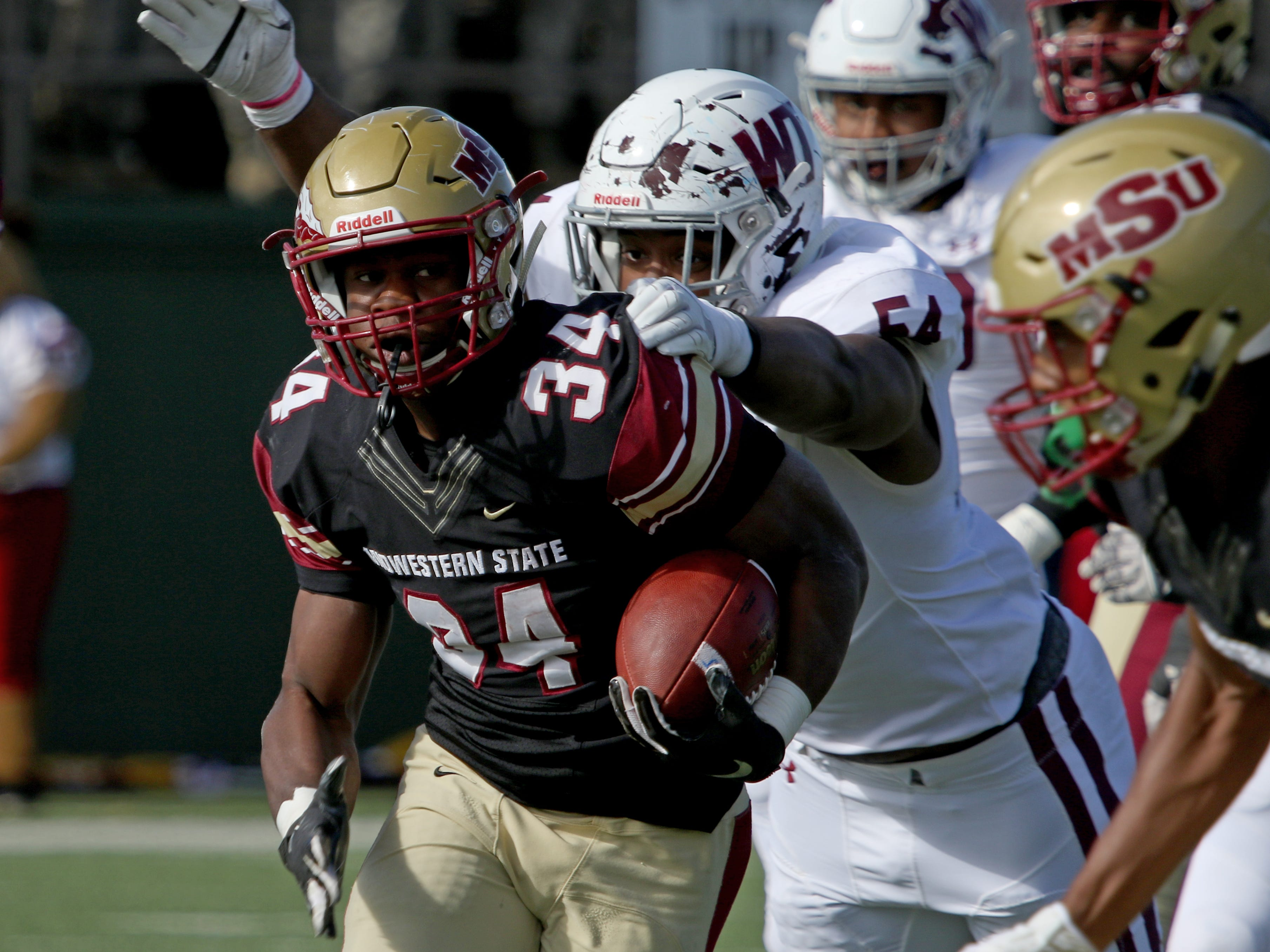 Midwestern State's Vincent Johnson runs for a large gain against West Texas A&M Saturday, Nov. 10, 2018, at Memorial Stadium. The Mustangs defeated Buffs 24-23 in overtime.