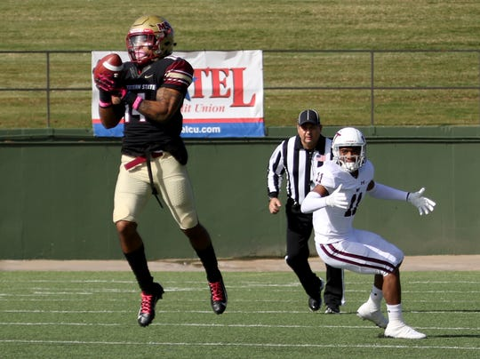 Midwestern State's Paul Manus intercepts West Texas A&M Saturday, Nov. 10, 2018, at Memorial Stadium. The Mustangs defeated Buffs 24-23 in overtime.