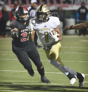 Wichita Falls Rider running back Samuel Manuel (1) cuts inside as Wichita Falls High defender Makkedah Brown (21) moves in for the tackle during their game Friday, Nov. 9, 2018. Rider won 45-27.