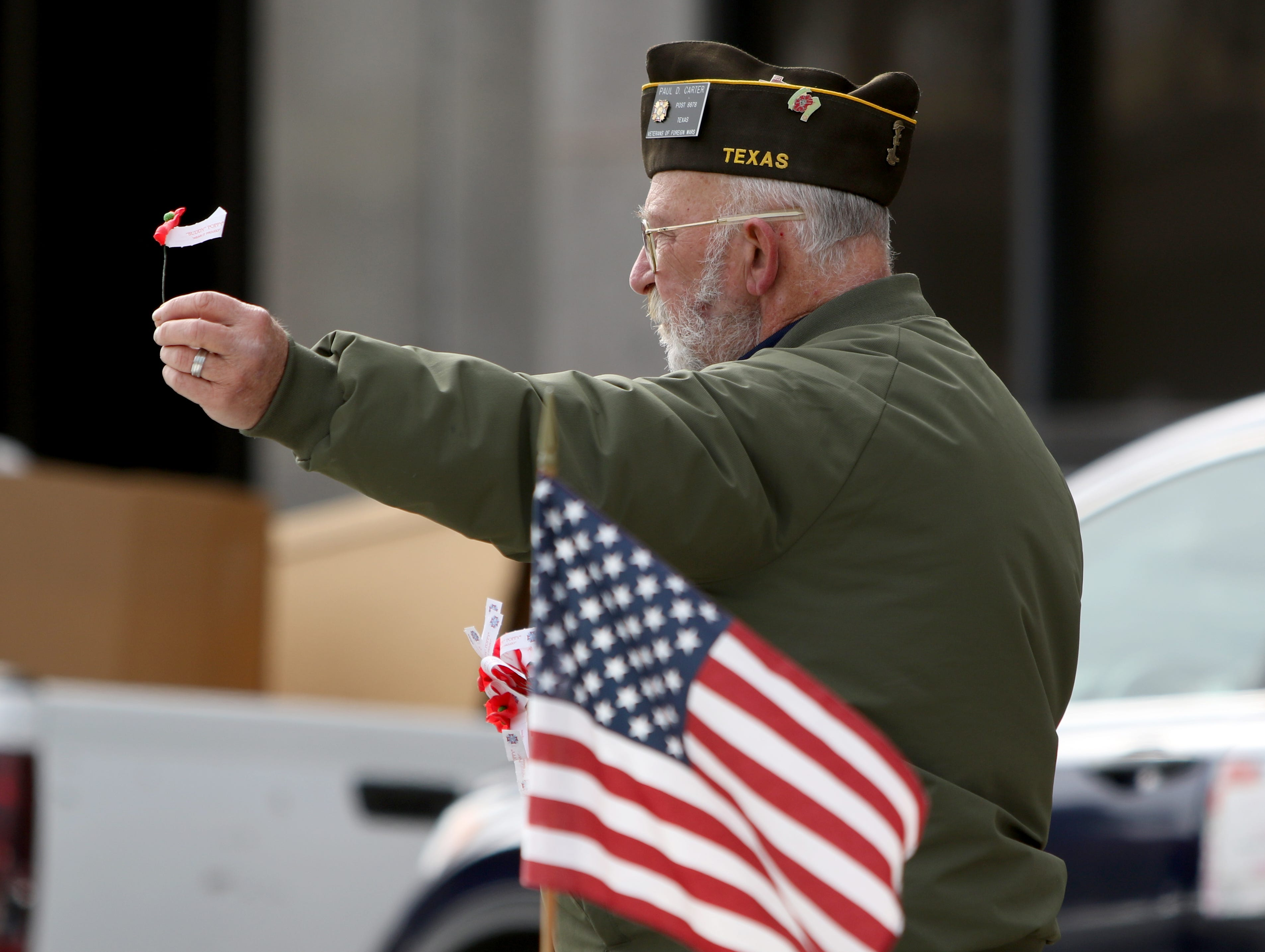 Paul Carter, VFW post 8878, hands out poppies during the Veterans Day parade Saturday, Nov. 10, 2018, in downtown Wichita Falls on the 100th anniversary of the Armistice of Compiègne that ended fighting in World War I.