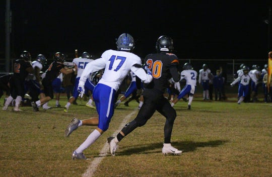 City View's Darion Harbuck and Nocona's Tyler Richards face off on the sideline. Nocona defeated City View tonight at home, ending the Mustang's season.