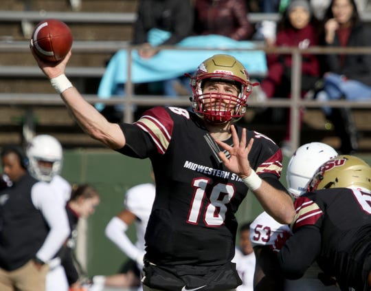 Midwestern State's Layton Rabb passes in the game against West Texas A&M Saturday, Nov. 10, 2018, at Memorial Stadium. The Mustangs defeated Buffs 24-23 in overtime.