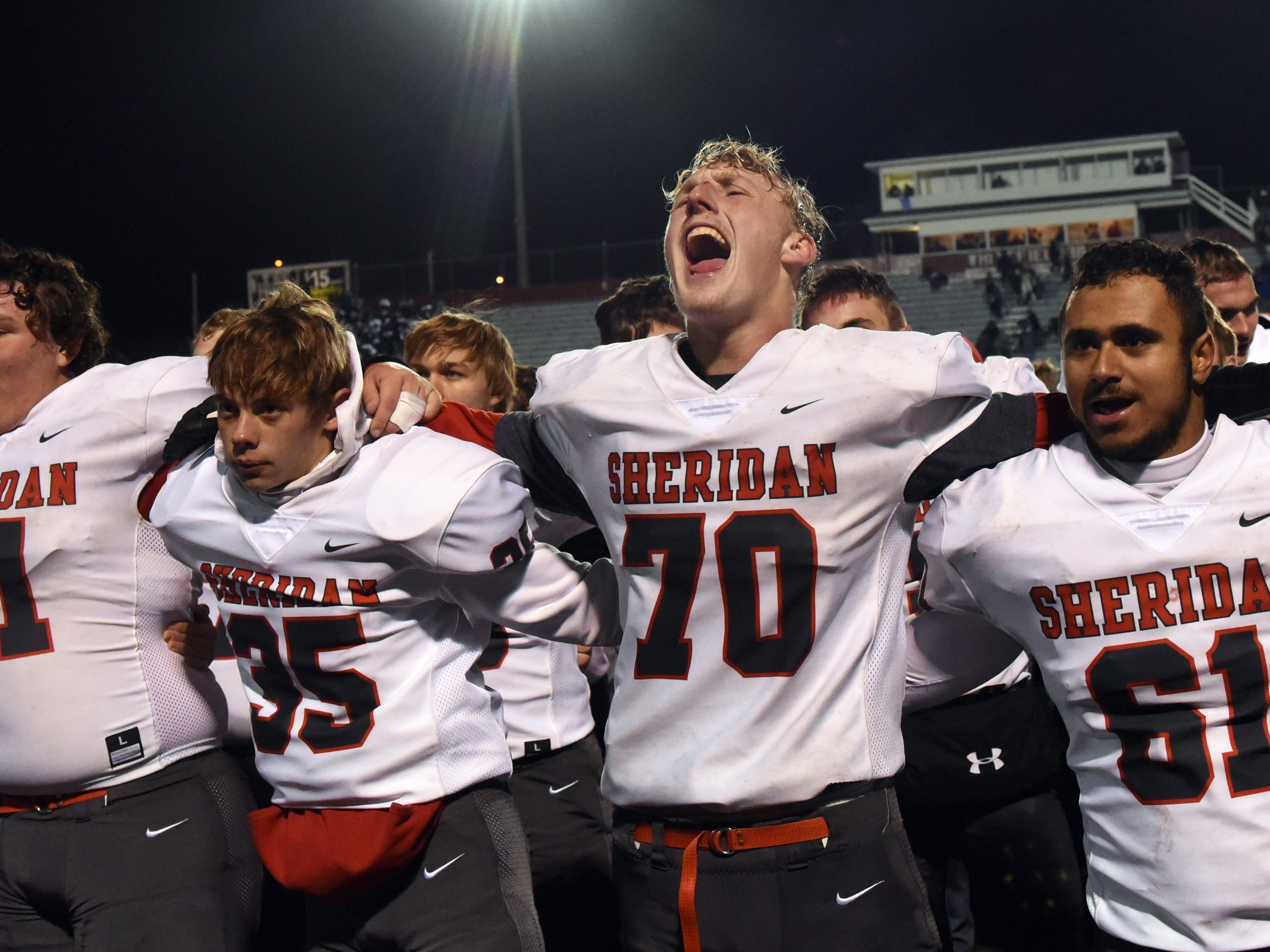 Sheridan senior Owen Loughman enthusiastically sings the schools alma mater after defeating Granville 20-7 in a Division III, Region 11 semifinal on Friday, Nov. 9, 2018 at White Field in Newark.