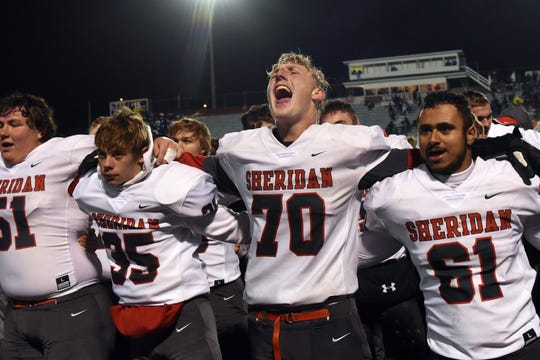 Sheridan senior Owen Loughman enthusiastically sings the school's alma mater after defeating Granville, 20-7, in a Division III, Region 11 semifinal on Friday, Nov. 9, 2018 at White Field in Newark.
