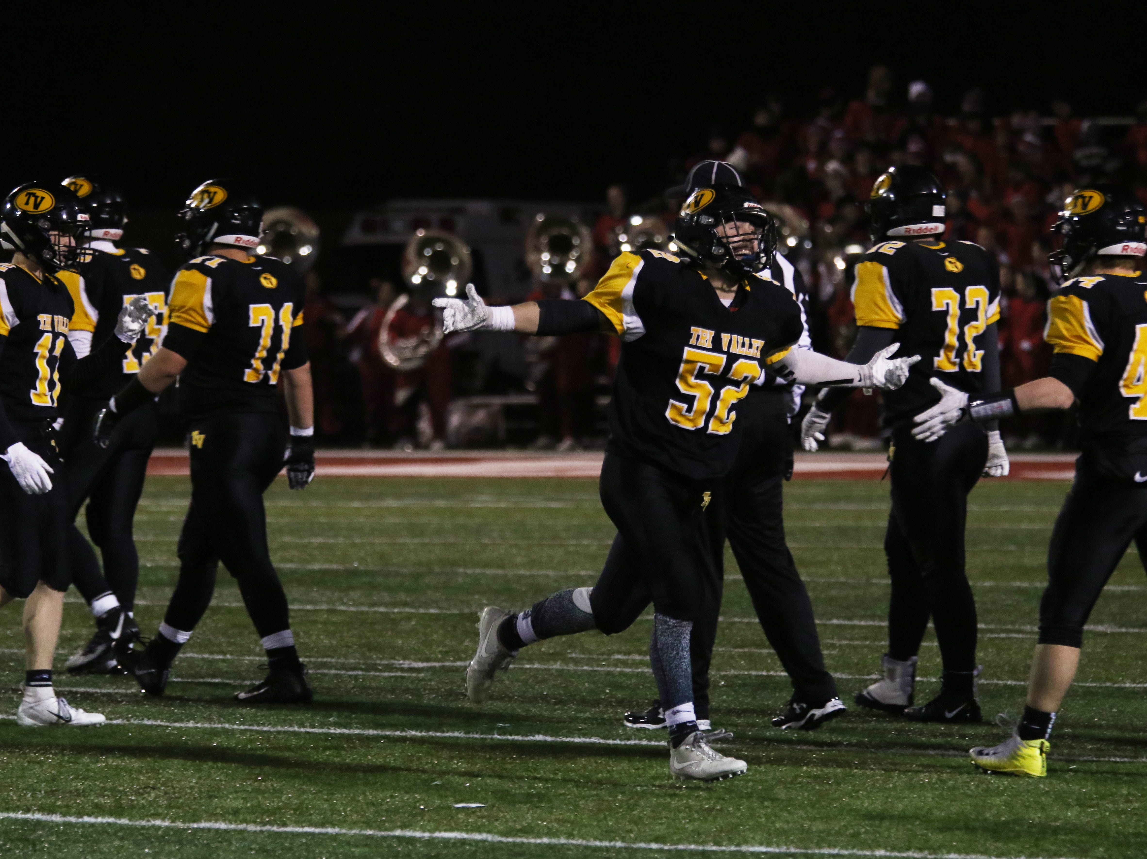 Tri-Valley's Tom Reiss celebrates a play against Wadsworth.