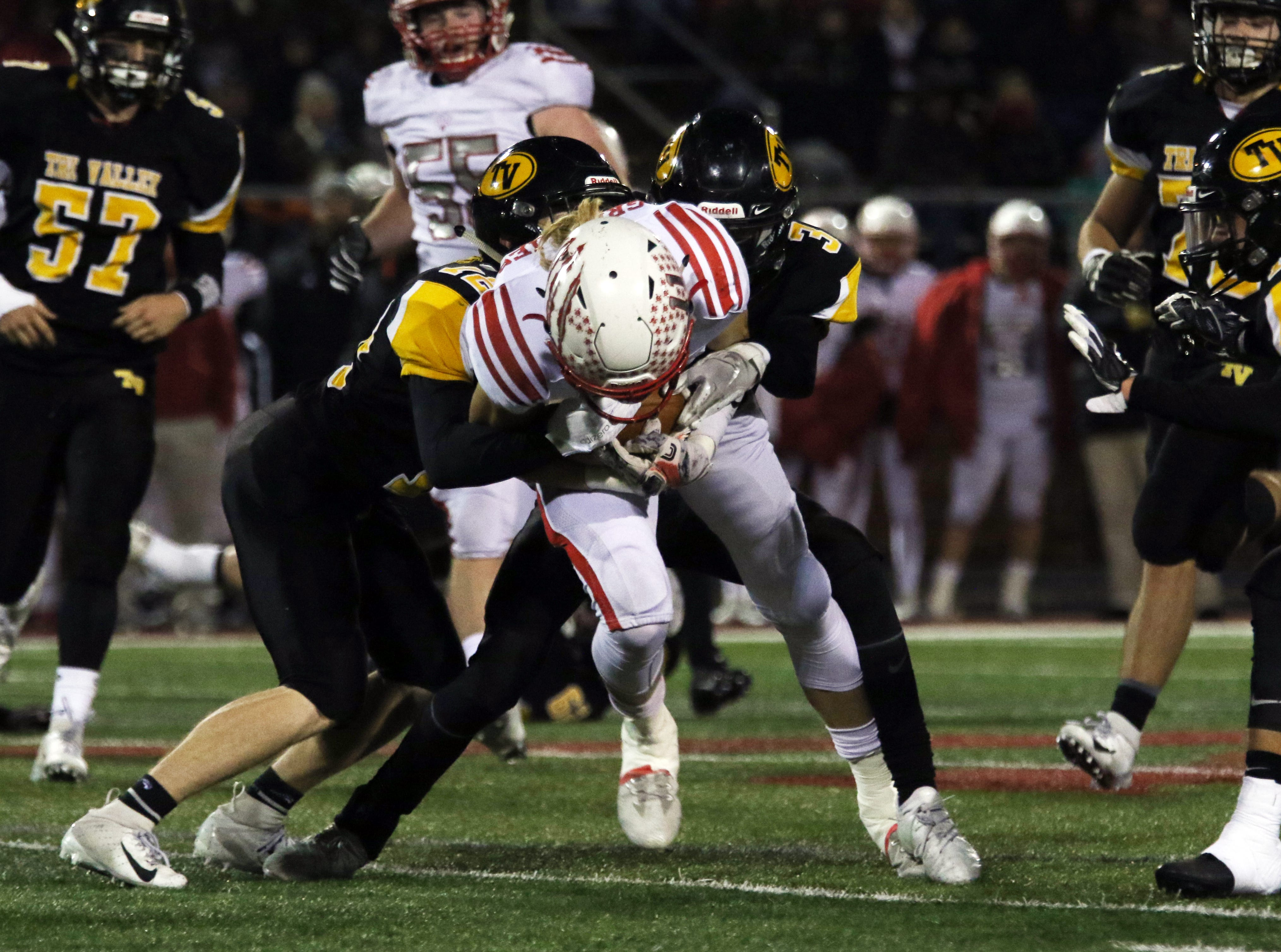 Tri-Valley defenders bring down a Wadsworth ball carrier.