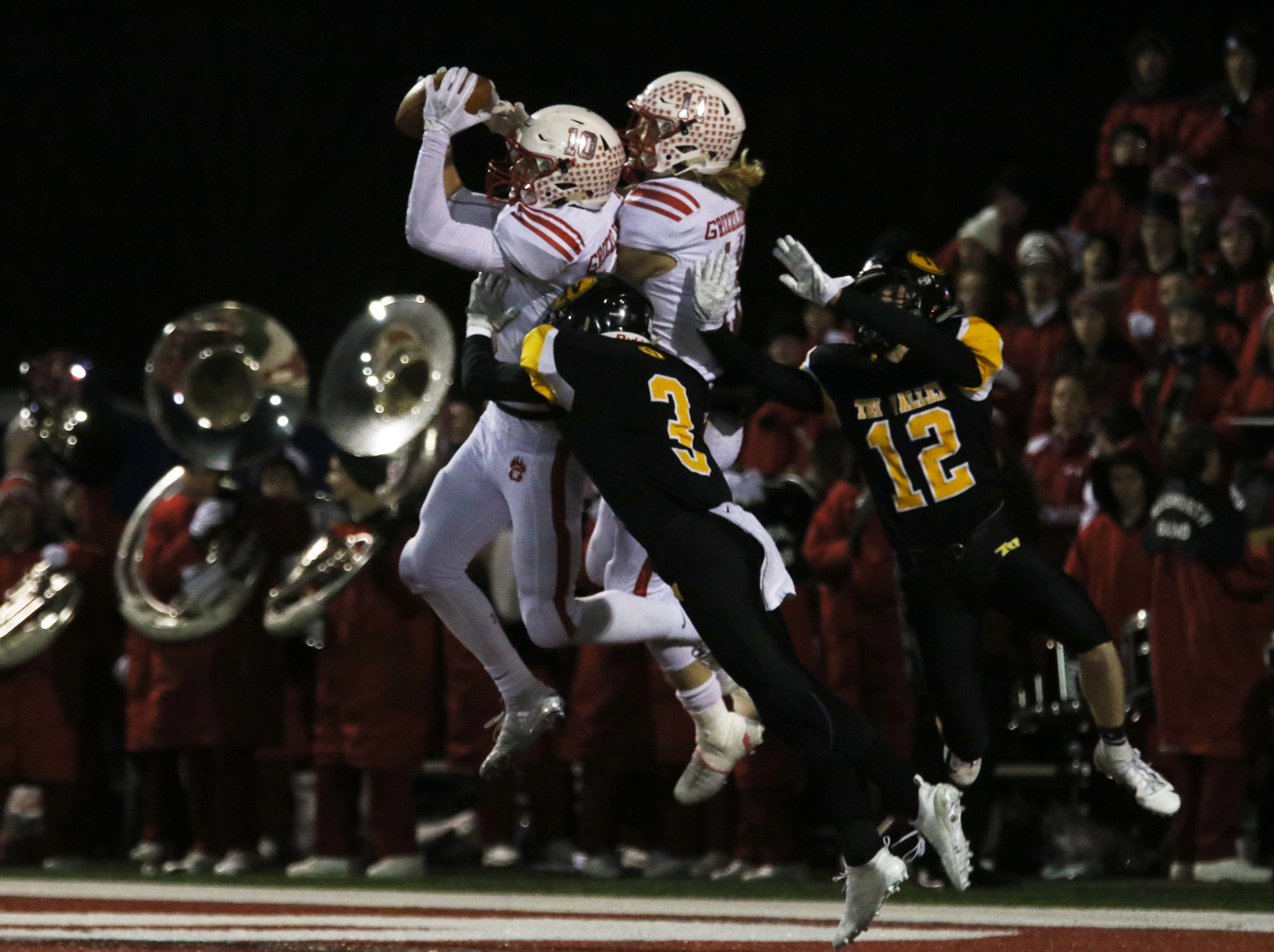 Wadsworth's Tyler Montgomery pulls in a touchdown pass despite the efforts of Tri-Valley's Cade Sterling.