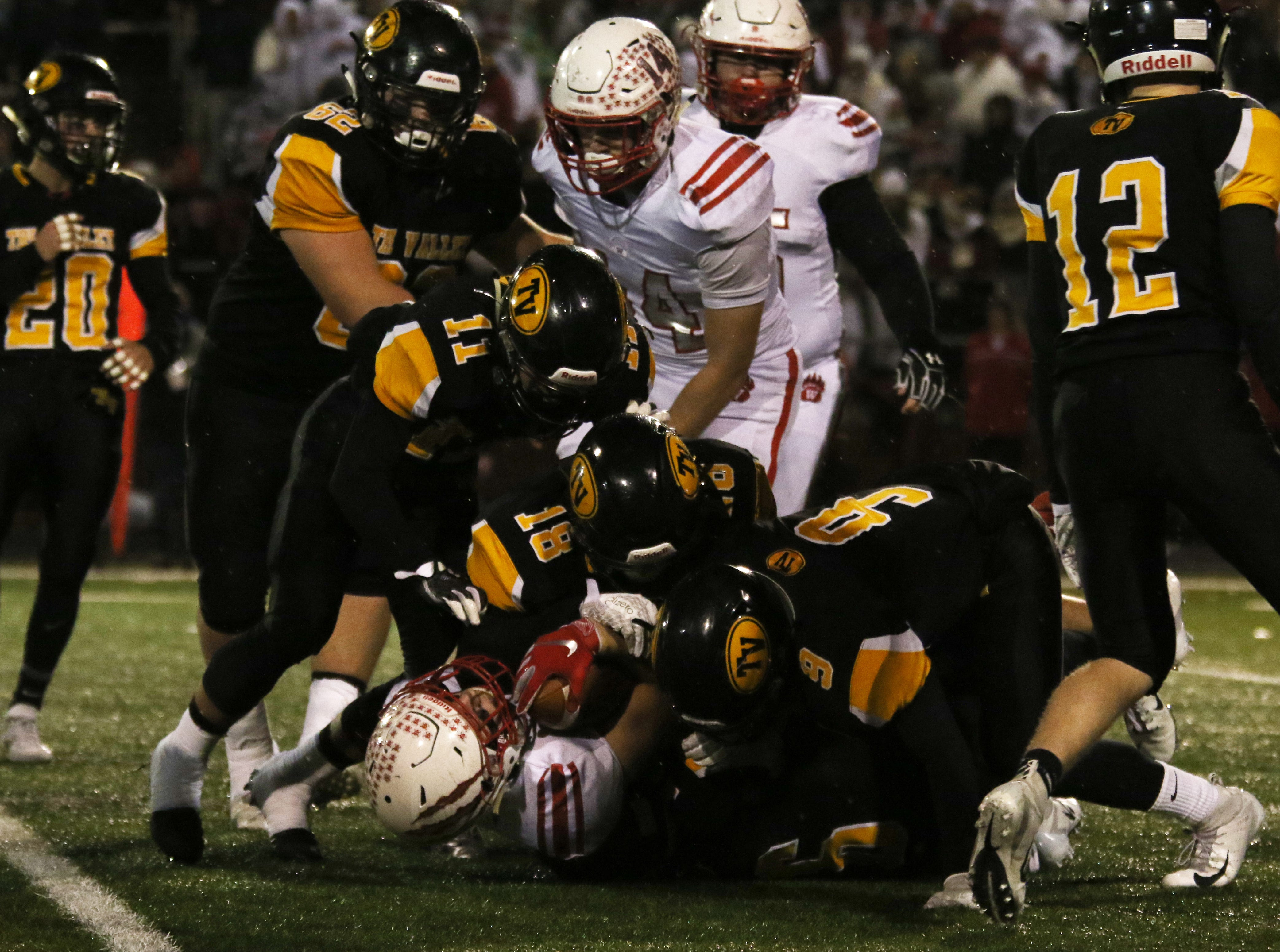 The Tri-Valley defense brings down a Wadsworth ball carrier.