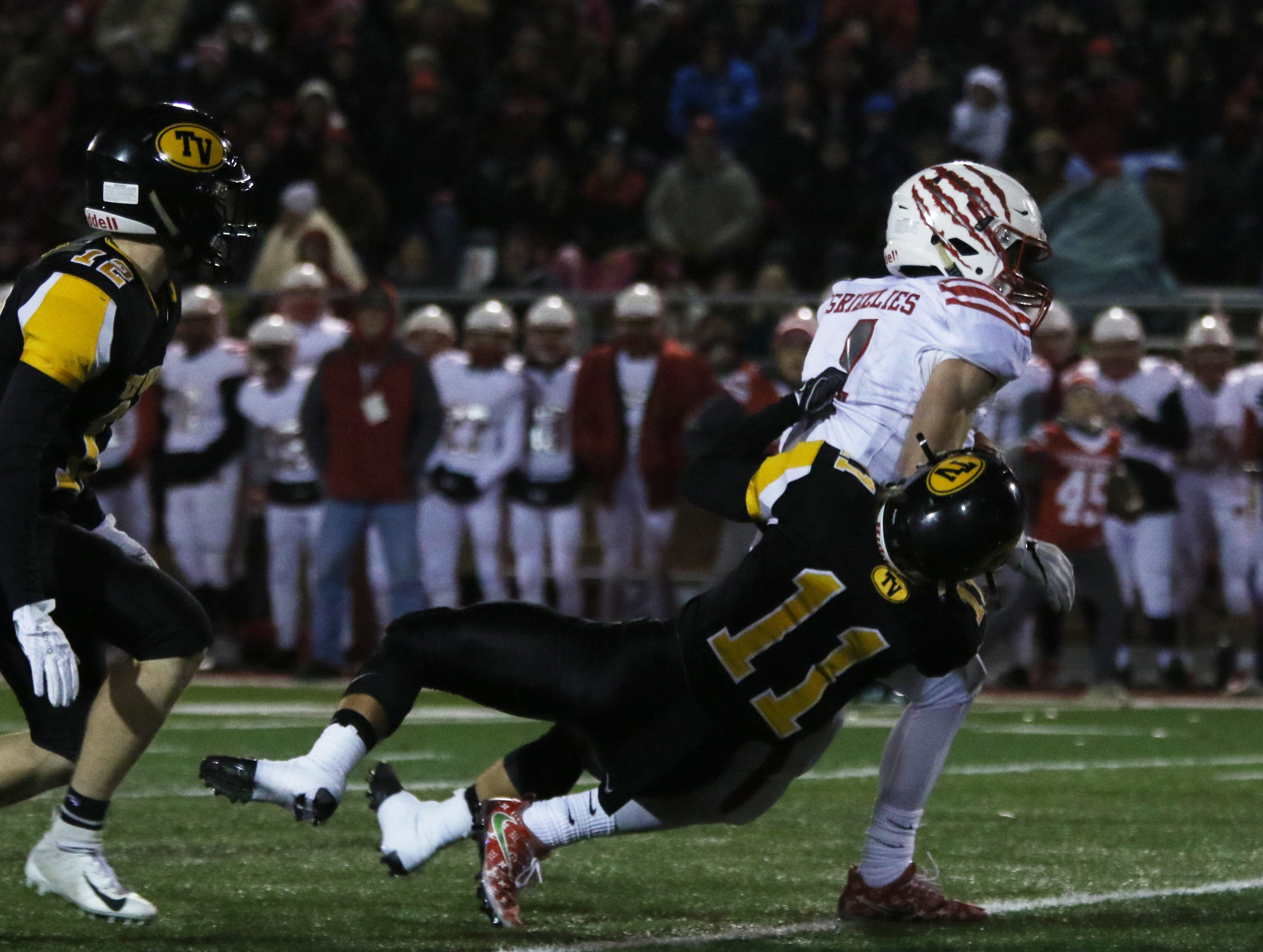 Tri-Valley's Ben Reiss pulls down a Wadsworth ball carrier.