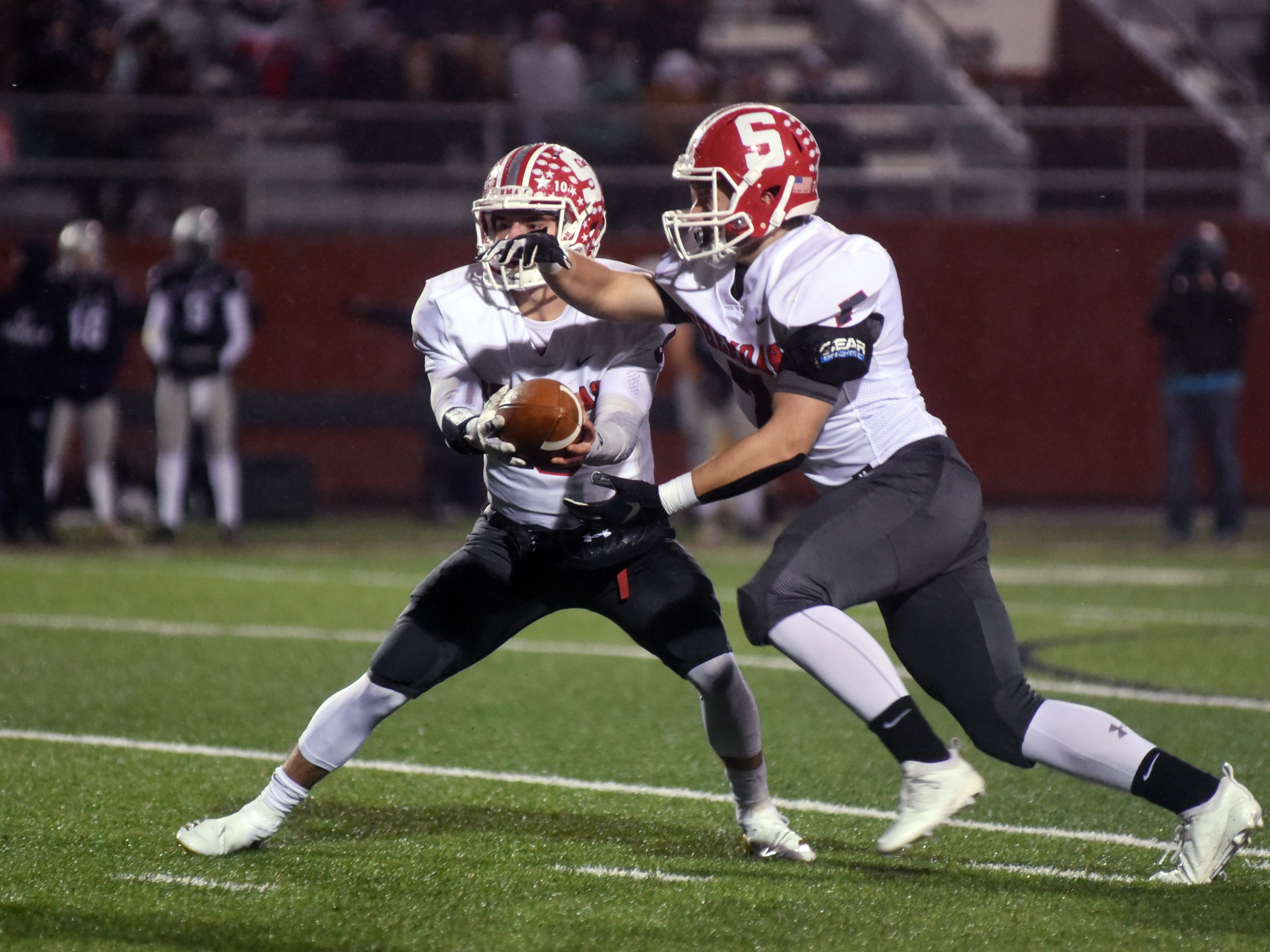 Sheridan's Ethan Heller runs the read option with Will Hamilton during the second half against Granville.