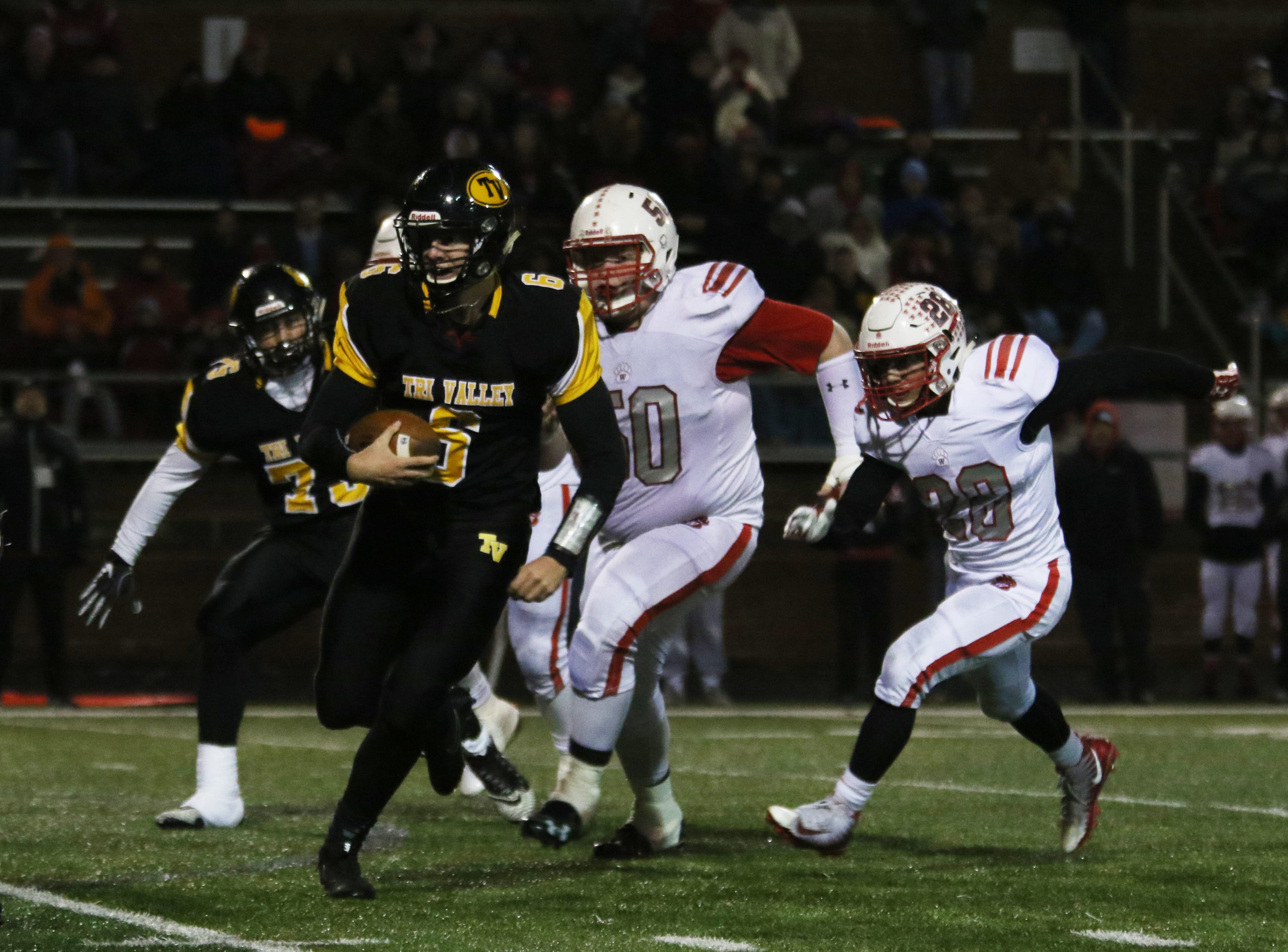 Tri-Valley's Luke Fargus carries the ball against Wadsworth.