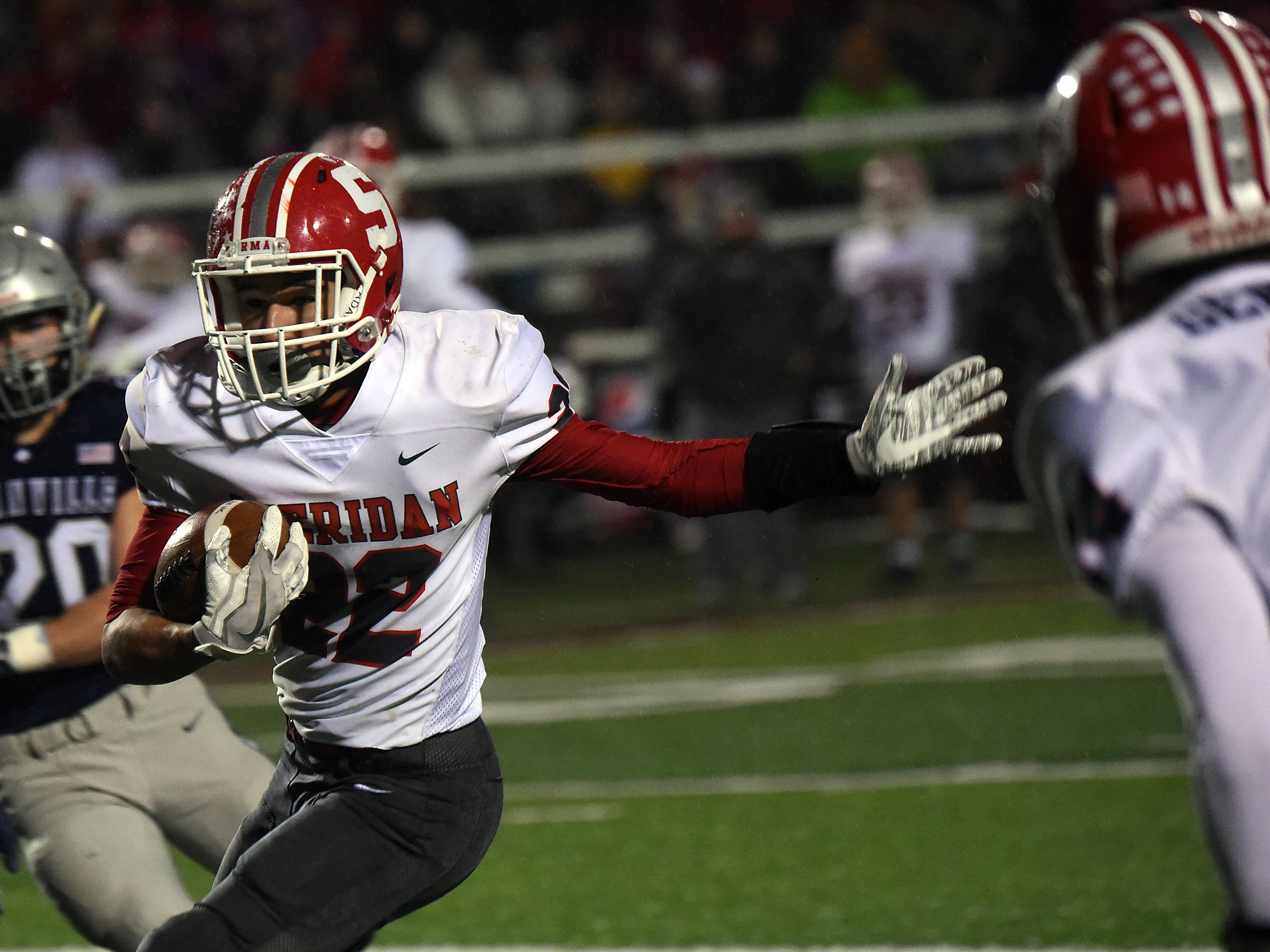 Sheridan senior running back Isaiah Austin carries the ball during Friday night's Division III, Region 11 semifinal. The Generals defeated the Blue Aces 20-7 on Friday, Nov. 9, 2018 at White Field in Newark.
