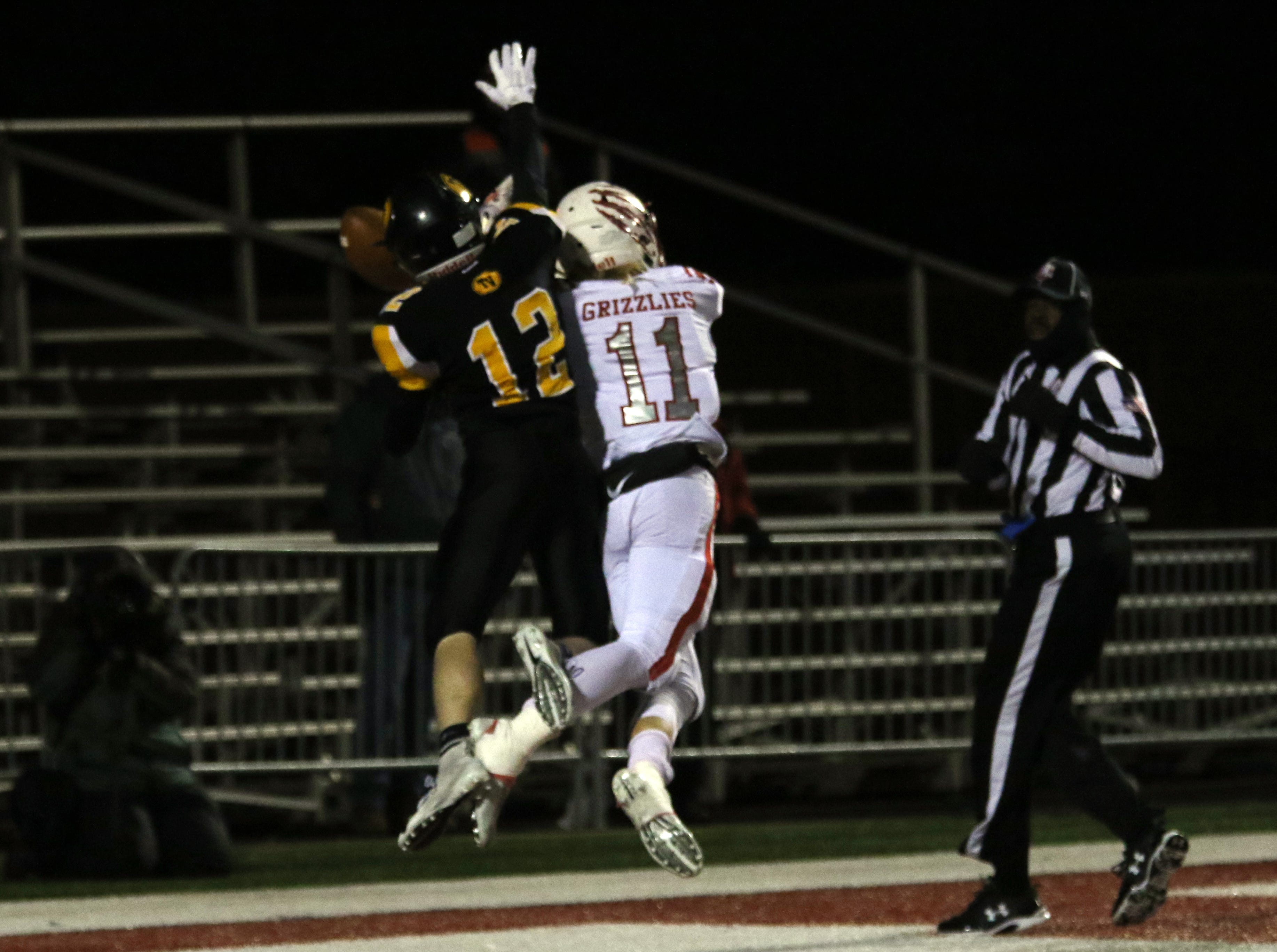 Tri-Valley's Graham Cameron breaks up a touchdown attempt from Wadsworth.