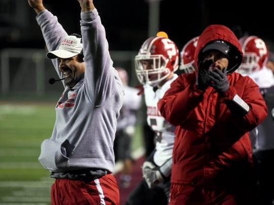 Sheridan coach Paul Culver III celebrates a first-quarter touchdown against Granville.