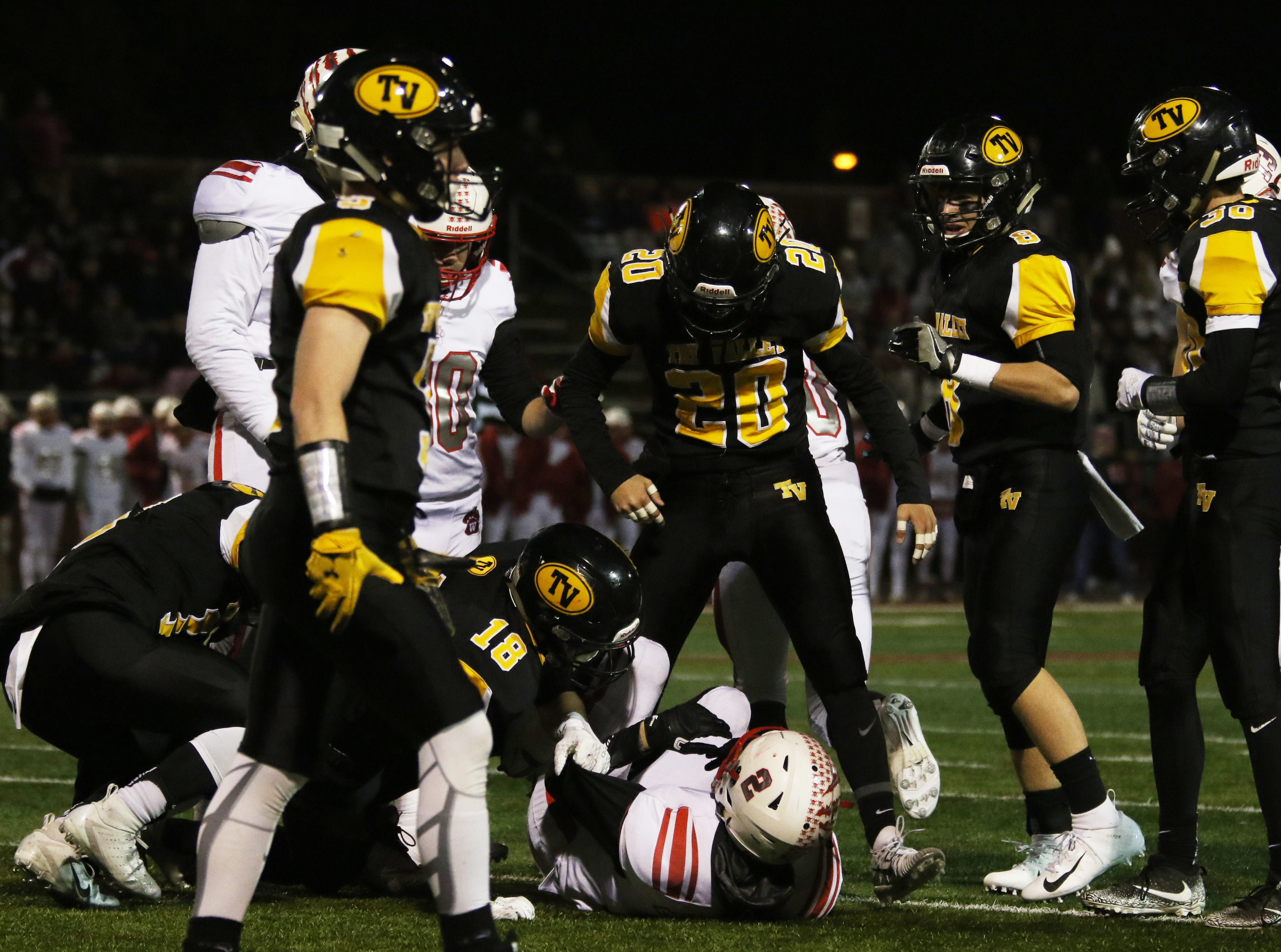 Tri-Valley's Hudson Brown makes his presence known to a Wadsworth ball carrier.