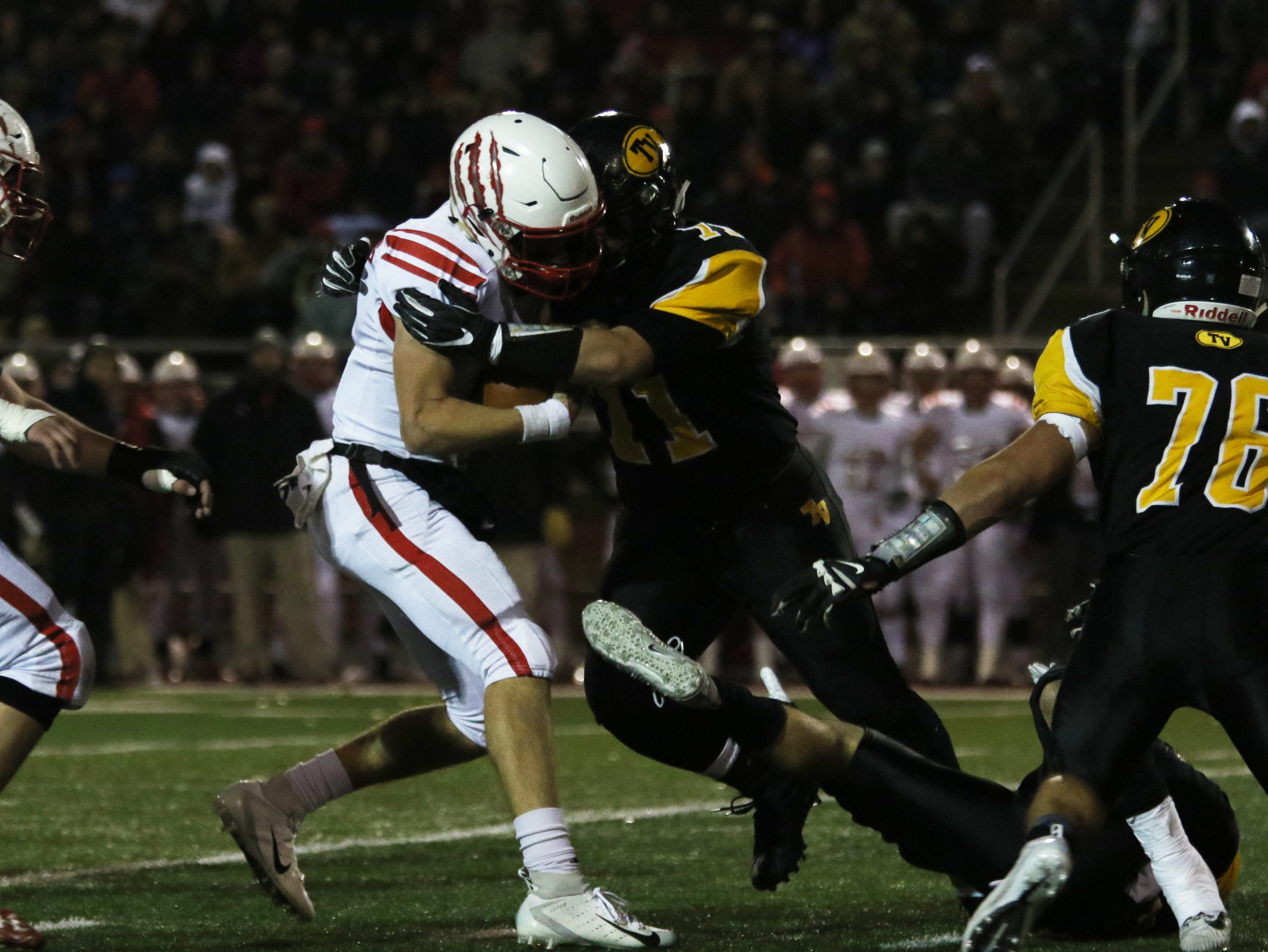 Tri-Valley's Garrett French tackles a Wadsworth ball carrier.