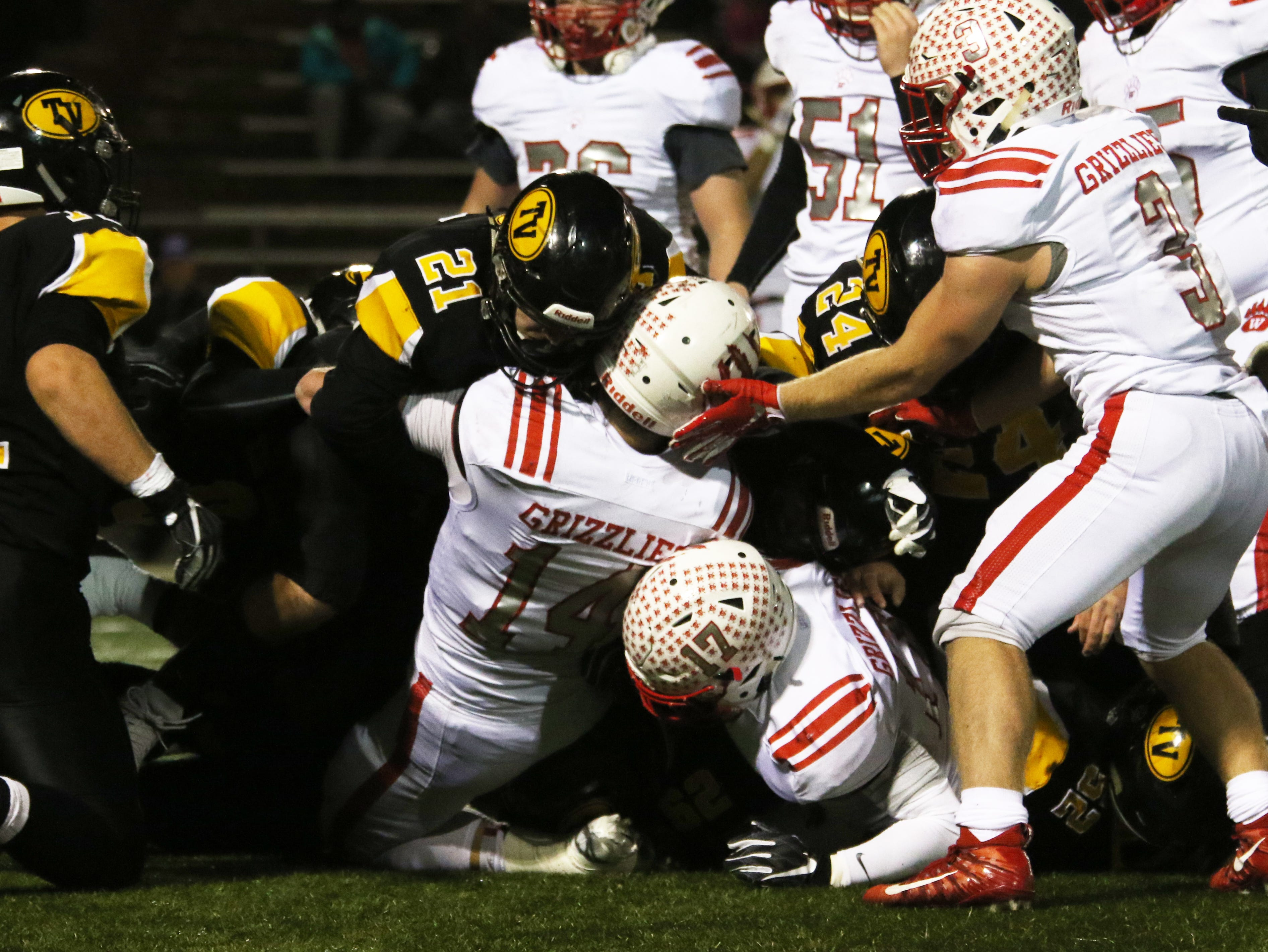 Tri-Valley converges on a Wadsworth ball carrier. In on the action are Blake Kendrick (21) and Chase Kendrick (24).