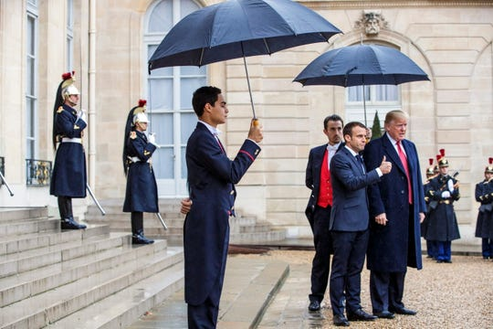 French President Emmanuel Macron greets President Donald Trump upon his arrival at the Elysee Palace in Paris on Saturday. Trump along with other heads of state and governments will attend the commemoration ceremonies for their countries' fallen WW1 soldiers in France.