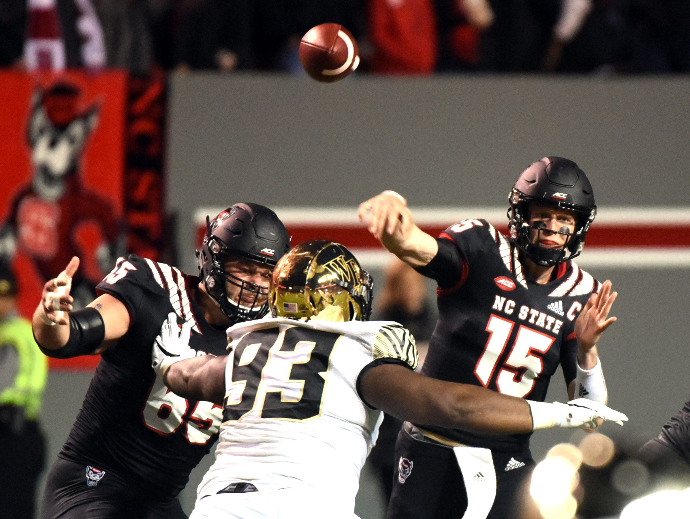 North Carolina State Wolfpack quarterback Ryan Findley (15) throws a pass during the first half against the Wake Forest Demon Deacons at Carter-Finley Stadium.