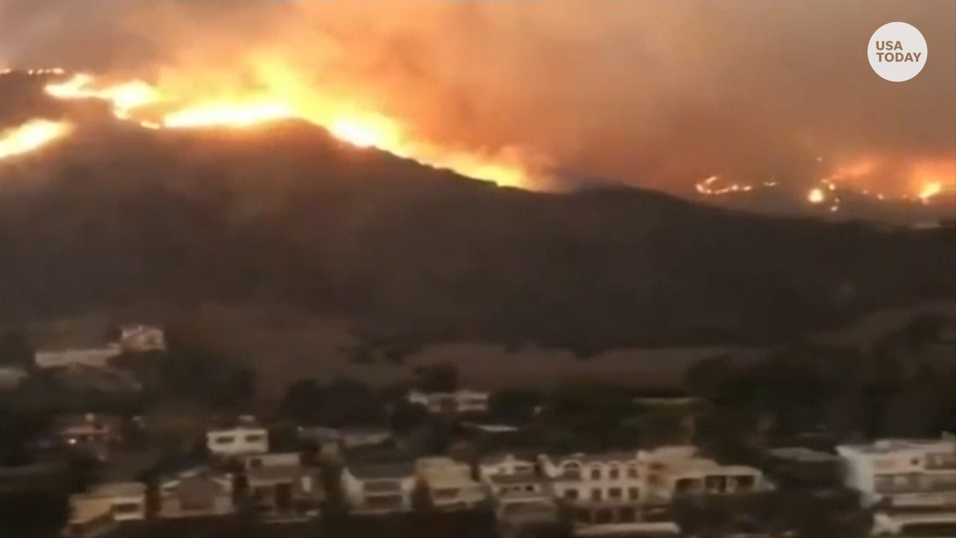 Ribbon of flames closes in on Pacific Coast homes near Malibu