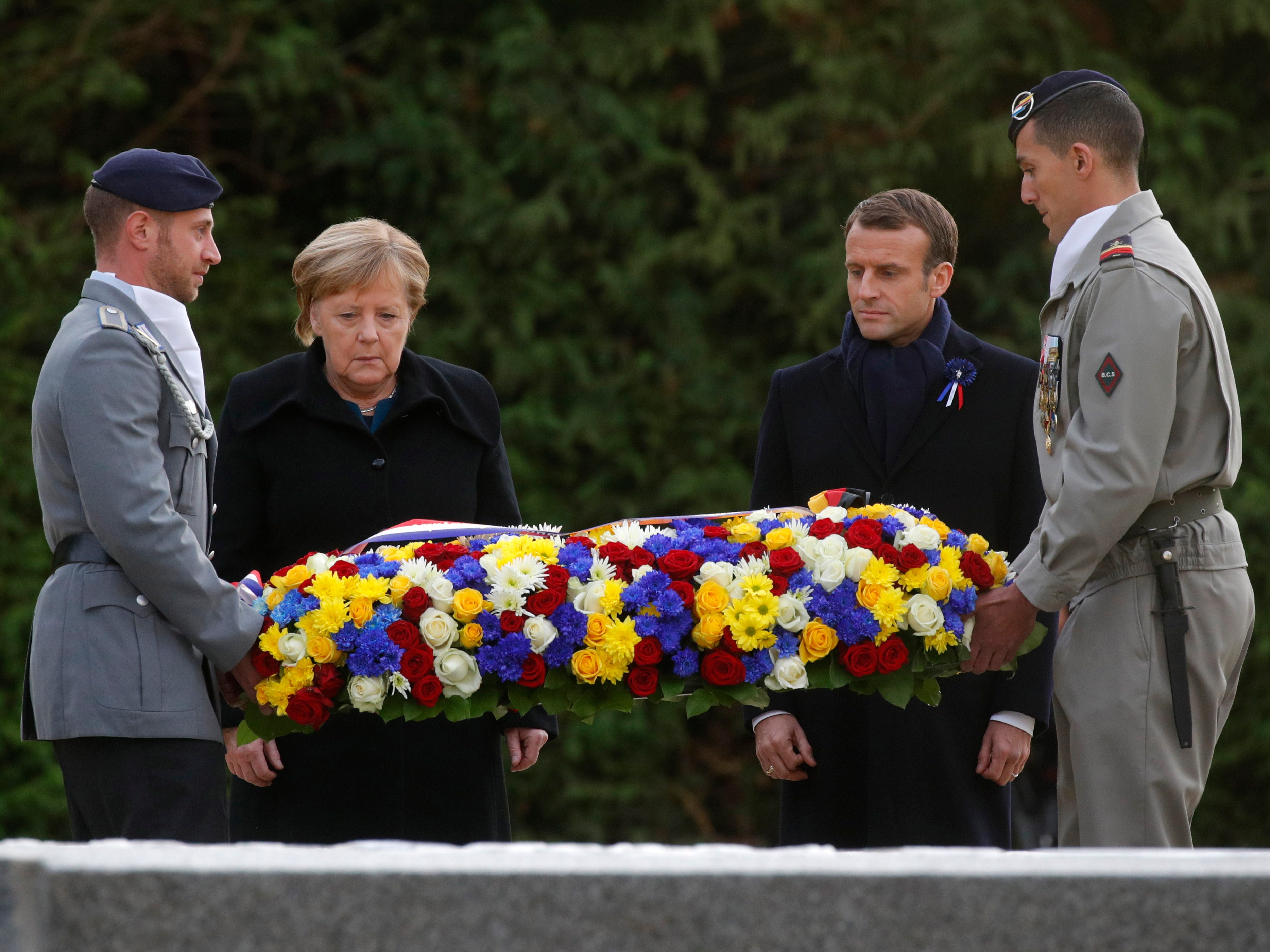 French President Emmanuel Macron and German Chancellor Angela Merkel lay a wreath in the Clairiere of Rethondes forest during a commemoration ceremony for Armistice Day, 100 years after the end of the First World War, in Compiegne, France on Nov. 10, 2018.