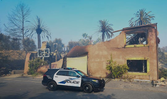 """A police cruiser patrols the area where the ABC series """"The Bachelor"""" is filmed on Nov. 11, 2018, where a neighboring house was destroyed."""