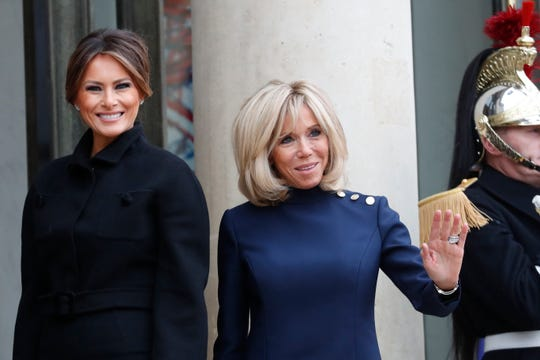Brigitte Macron, wife of French President Emmanuel Macron, and first lady Melania Trump pose at the Elysee Palace in Paris, on Saturday. President Donald Trump is joining other world leaders at centennial commemorations in Paris this weekend to mark the end of World War I.